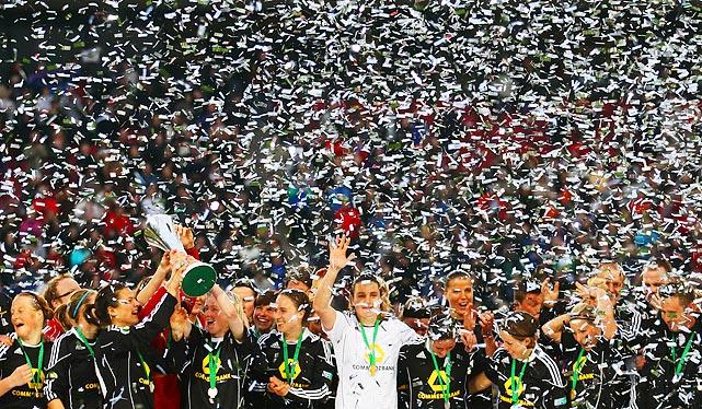 1. FFC Frankfurt celebrates amid confetti after winning the DFB women's Cup final match over Turbine Potsdam on March 26.
