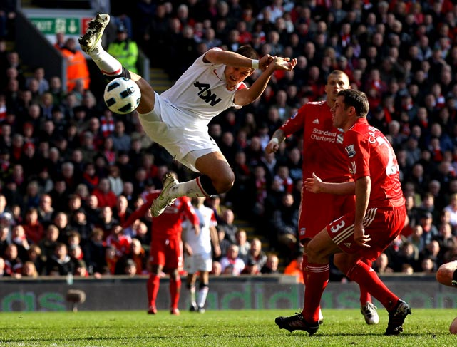 Javier Hernandez of Manchester United competes with Jamie Carragher of Liverpool during a Barclays Premier League match on March 6 in Liverpool. Manchester lost 3-1.