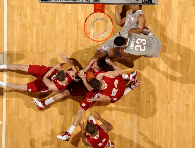 Wisconsin and Ohio State players scramble for the ball during a 93-65 win by the Buckeyes on March 6 at Value City Arena in Columbus.