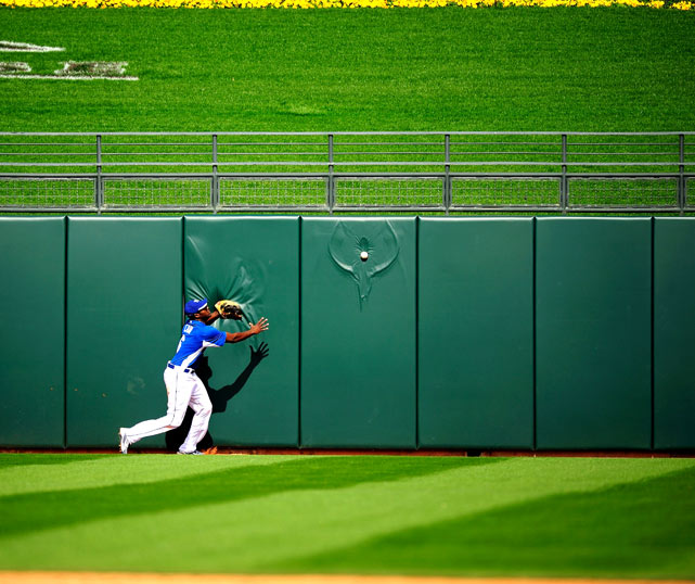 Lorenzo Cain of the Colorado Rockies fields a ball in a spring training game against Kansas City on March 5 in Surprise, Ariz.