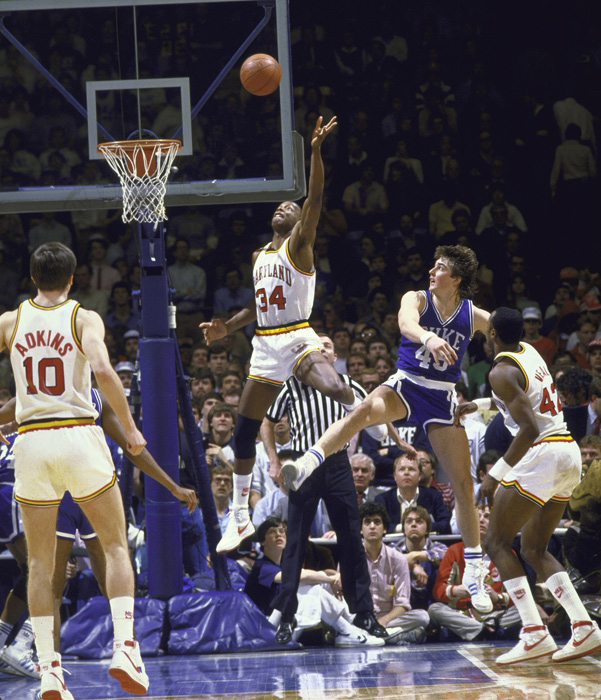 Bias recorded 87 blocked shots in his four seasons at Maryland. Here he attempts to swat a shot against Duke in 1984.