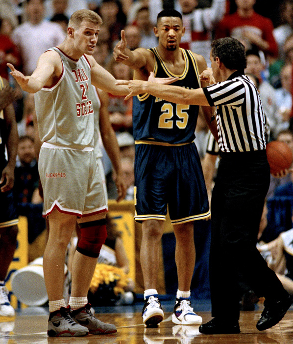 Michigan earned a No. 6 seed in the 1992 NCAA Tournament. In the Elite Eight, the Wolverines earned a rematch against Ohio State, which had beaten them twice during the regular season by double digits. In this photo, Chris Jent and Juwan Howard argue with the ref after a double technical foul was called on both.