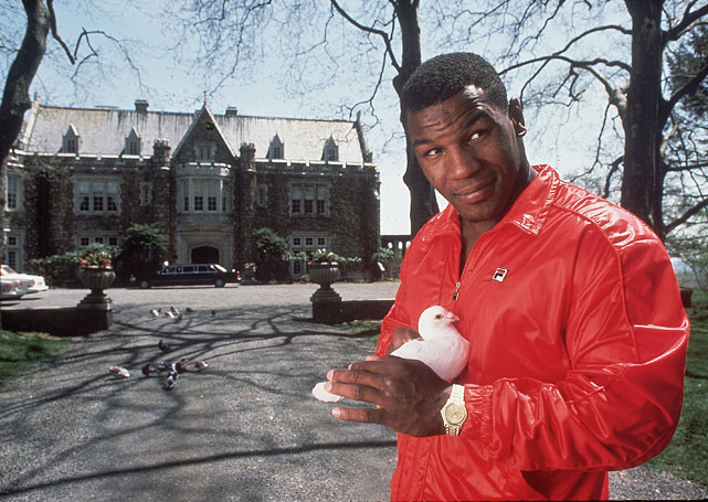 Tyson holding a pigeon outside his home in Bernardsville, N.J., at the height of his championship reign.