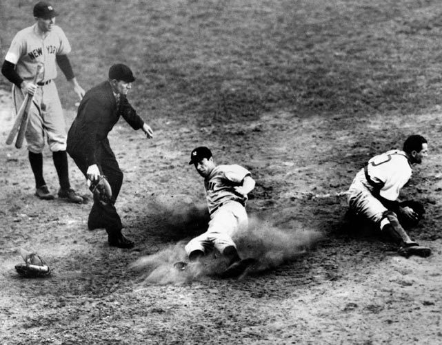DiMaggio sliding safely for the go-ahead run in the ninth inning of the Yankees 7-4 win over the Dodgers in Game 4 of the 1941 World Series.