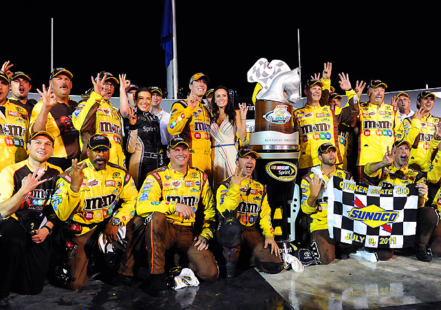 Kyle Busch held off David Reutimann and Jimmie Johnson after a late restart to win the inaugural Sprint Cup race at Kentucky Speedway and nab his third Cup victory of the year.