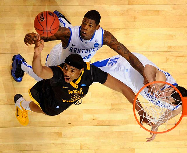 West Virginia forward Kevin Jones reaches for one of his team-leading nine rebounds during the Mountaineers third round loss to Kentucky.
