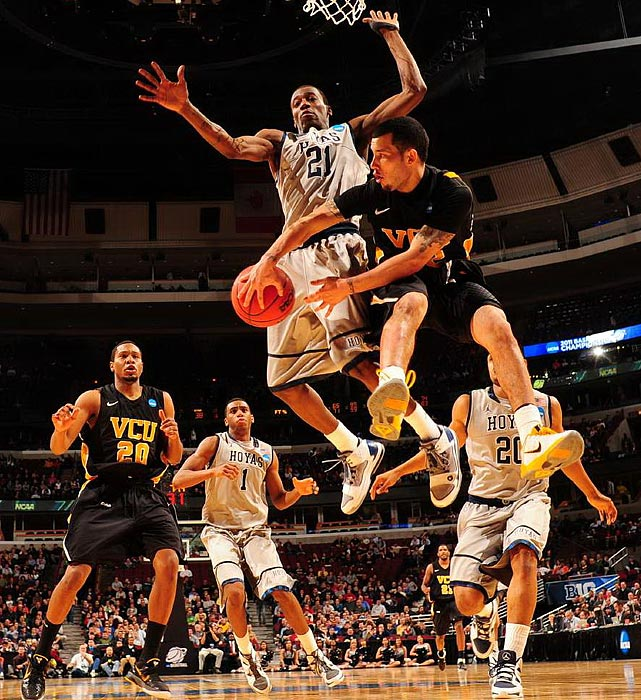 Joey Rodriguez (right) led the Rams with seven assists as VCU knocked off Georgetown.  The loss marked the third straight NCAA tournament in which Georgetown lost to a double-digit seed.