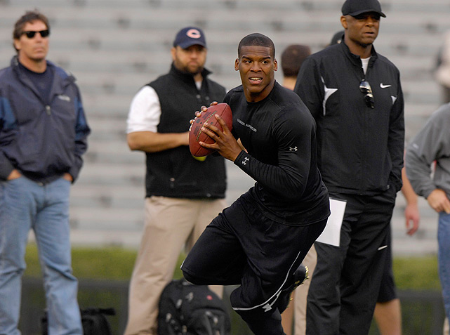 Cam Newton, in the running to be the first overall selection in April's draft, throws for scouts during Auburn's pro day.