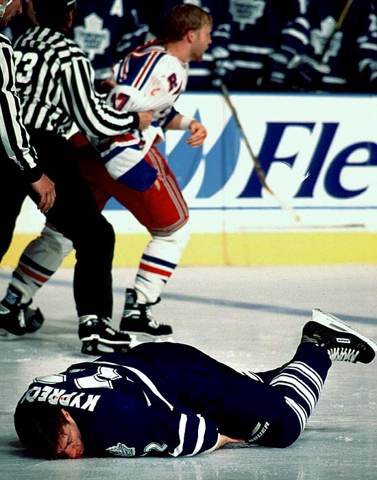 "Kypreos, a grinding winger, played eight seasons in the NHL, suffering multiple concussions before his career was ended by one sustained in a fight with Ryan Vandenbussche of the Rangers during the 1997-98 preseason. ( CLICK HERE for video.  ""I lost my helmet and hit my head on the ice,"" Kypreos told Hockey Canada. ""It's like a dream you can't remember. Within one hour everything started to come back into focus. I was being asked how I was feeling and if I could go back on the ice to finish the game."""