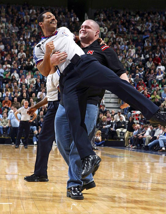 NBA official Tom Washington is helpless as Gardner carries him across the floor during a Miami Heat-Utah Jazz game in Utah.