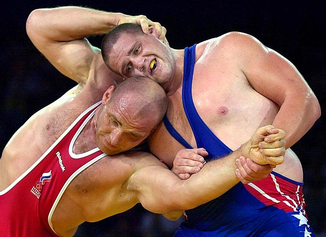Alexander Karelin attempts to overpower Gardner during their 130-kilogram division Olympic gold medal match in 2000.  Karelin had won the gold in 1992 and 1996 and had not lost an international match in 10 years.