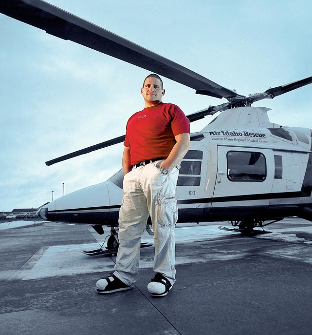 On two feet but only nine toes, Gardner poses in front of the helicopter that rescued him from a snowmobile mishap that left him stranded in the wilderness.