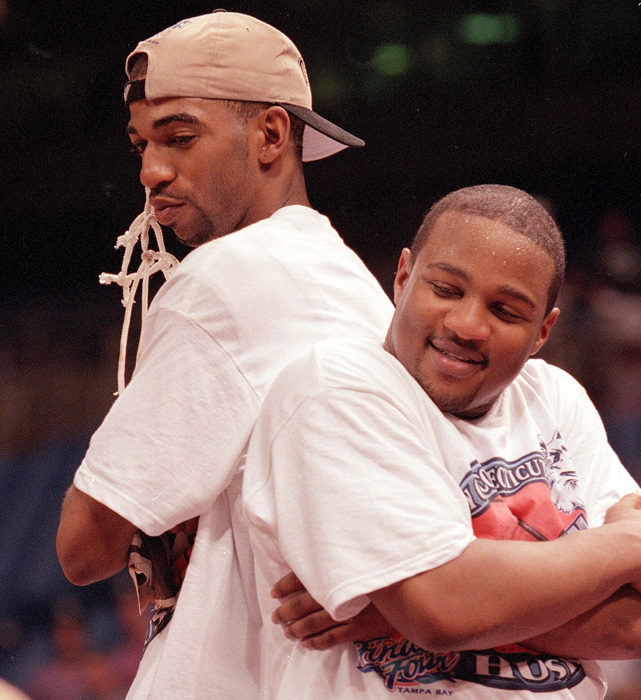 Richard Hamilton and Khalid El-Amin pose after leading the Huskies to their first national championship.