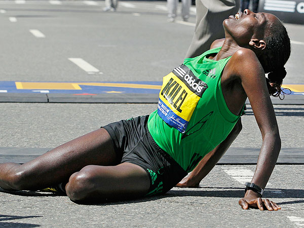 Caroline Kilel rests her weary legs after winning the women's division of the 115th Boston Marathon.
