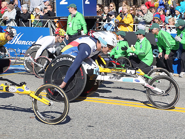 South Africa's Ernst Van Dyk pulls out to an early lead in the wheelchair division of the 115th Boston Marathon. Van Dyk would finish in third behind winner Masazumi Soejima.