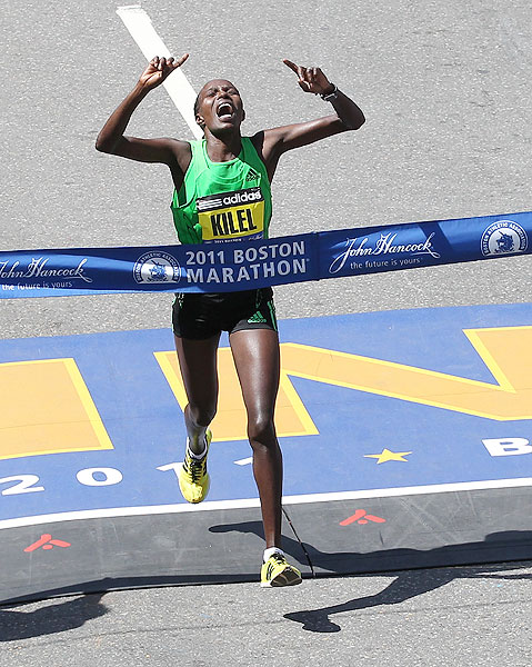 Kenya's Caroline Kilel celebrates winning the women's division of the 115th Boston Marathon.