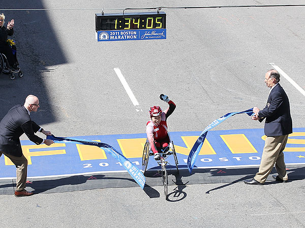 Wakako Tsuchida celebrates winning the women's wheelchair division of the 115th Boston Marathon.