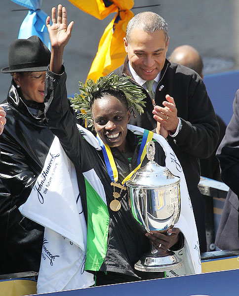 Kenya's Caroline Kilel poses with the trophy after her victory in the women's division of the 115th Boston Marathon.