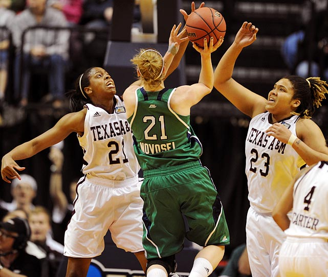 Adaora Elonu (21) blocks a shot attempt by Notre Dame's Natalie Novosel. Elonu's defense in Texas A&M's semifinal victory over Stanford was crucial to the Aggies' upset victory.