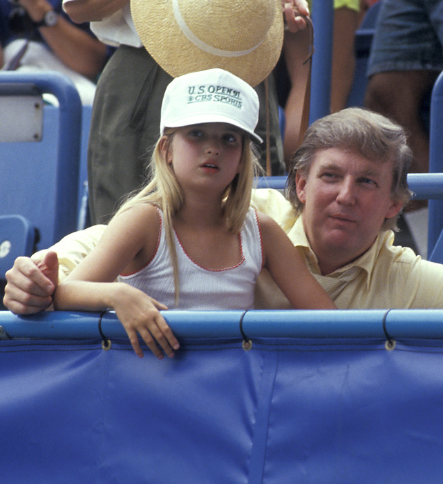 Ivanka Trump and her father take in a game in 1991.