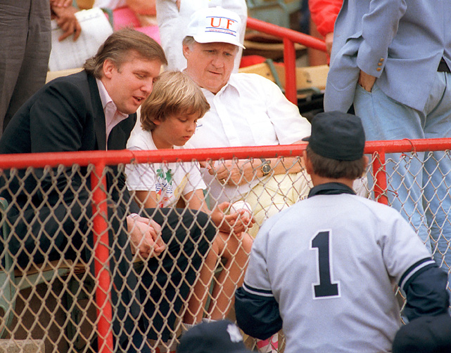 Yankees manager Billy Martin jogs out to meet Trump and his son Donald, who are seated with Yankees owner George Steinbrenner during a spring training game against the Expos in 1988. New York finished fifth in the AL East that season.