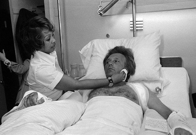 "Knievel's face is wiped by a nurse at Chicago's Michael Reese Hospital in 1977 after the stuntman was hurt during a practice run in the city. Knievel told reporters that he ""knew there would be an accident,"" and he made a practice run so that no one else would be injured by a crash"
