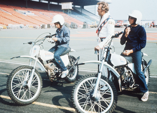 Knievel stands next to his sons Kelly, 14, (left) and Robbie, 12, at the Canadian National Exhibition Stadium in 1974. Robbie followed in his father's footsteps as a motorcycle-jumping daredevil.