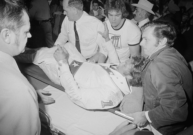 At an event at the Cow Palace in Daly City, Calif., Knievel successfully jumped over 15 cars to set a new record, but he lost control of his bike after landing and suffered a leg injury. Seen here on a stretcher, the daredevil made an appearance in the arena before being taken to the hospital.