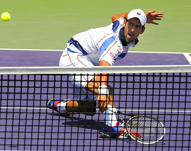 Novak Djokovic digs for a ball against Rafael Nadal in the finals of the Sony Ericsson Open. Djokovic won the match 4-6, 6-3, 7-6.