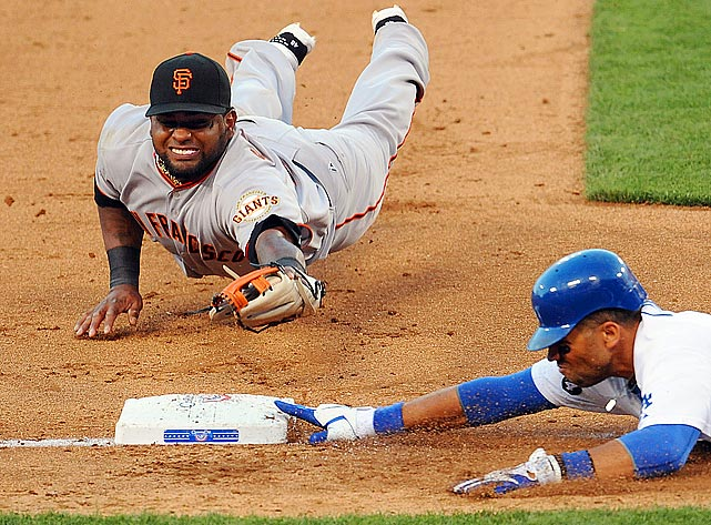 Despite his best efforts, San Francisco Giants third baseman Pablo Sandoval (top) can't double up Los Angeles Dodgers first baseman James Loney after catching a line drive.