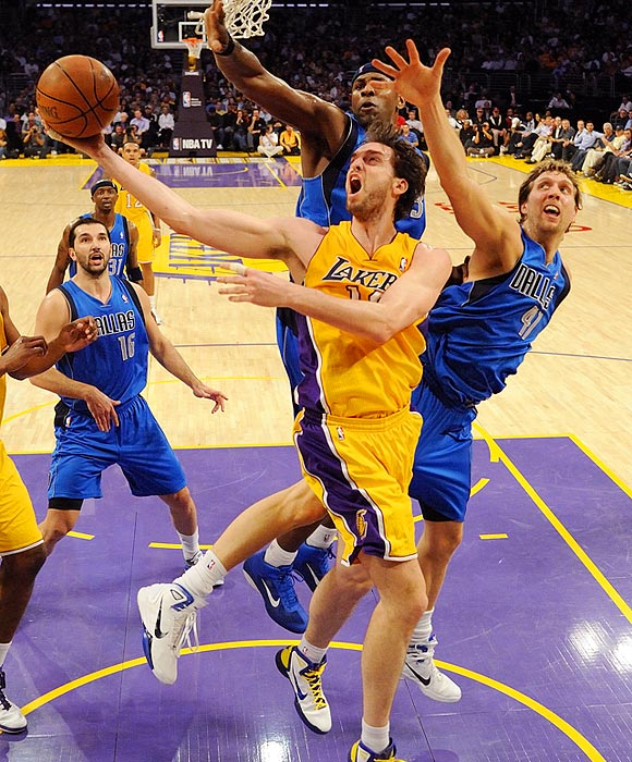 Los Angeles Lakers forward Pau Gasol goes up for a layup in a sea of Mavericks during the Lakers' 110-82 victory over Dallas.