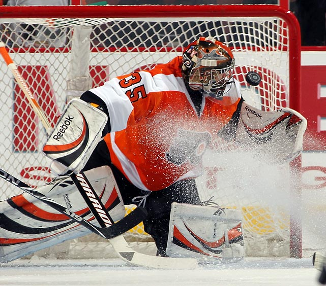 Philadelphia Flyers goalie Sergei Bobrovsky reaches for a save amid a sheet of ice shavings during the Flyers' 3-2 defeat at the hands of the New York Rangers.