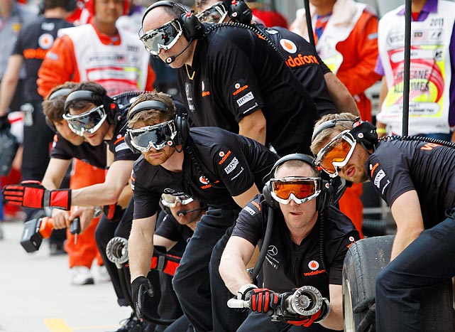 Though they could easily be mistaken for a laser tag gang, the McLaren Mercedes mechanics are true professionals.  Here they brace for a pit stop during the second practice session at the Sepang International circuit outside of Kuala Lumpur, Malaysia.