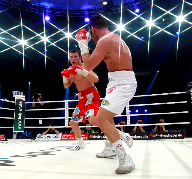 Under the bright lights, German boxer Robert Stieglitz (left) outlasted Armenia's Khoren Gevor -- who was suspended for a headbutt in the 10th round -- for the WBO super middleweight title.