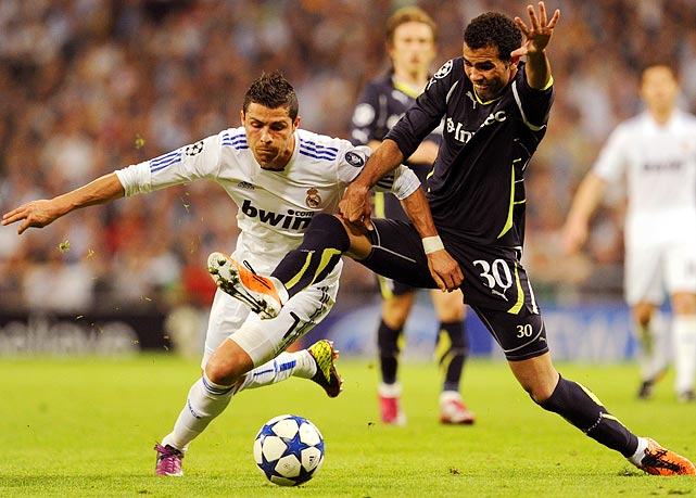 Tottenham Hotspur midfielder Sandro uses every part of his body to deny Real Madrid forward Cristiano Ronaldo during a Champions League quarterfinal leg on April 5.  Real Madrid would thrash Tottenham 4-0.