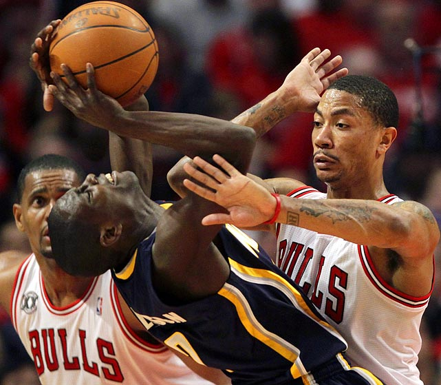 Chicago Bulls point guard Derrick Rose plays some overzealous defense on Indiana Pacers point guard Darren Collison during the Bulls' 104-99 come-from-behind win over the Pacers in Game 1 of their Eastern Conference quarterfinals match.