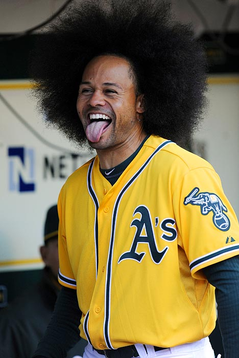 Oakland Athletics center fielder Coco Crisp, who normally wears his hair in braids, can't hide his enthusiasm over his new hairdo during an Athletics-Tigers game on April 14.