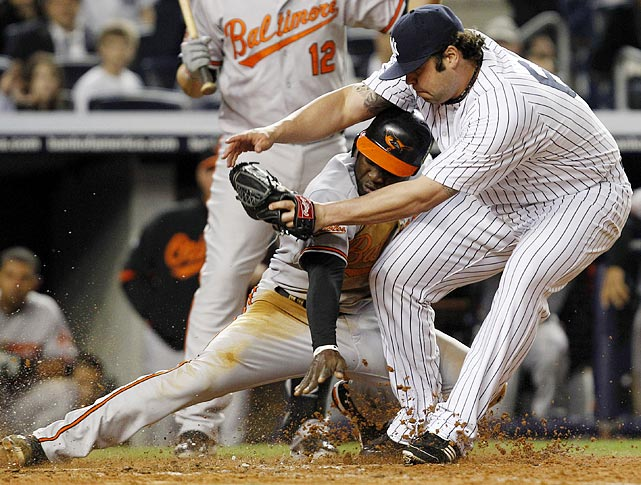 New York Yankees reliever Joba Chamberlain finally finds a use for his gargantuan girth, using it to block Baltimore Orioles outfielder Felix Pie from scoring on a wild pitch during the Yankees' 6-5 victory over the Orioles.