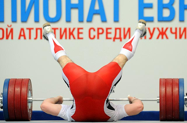 One hundred and five kilograms proved to be too much for Ukraine's Oleksiy Torohtiy, as he falls over attempting to lift said weight during the men's 105 kg weightlifting finals at the European senior weightlifting championships.