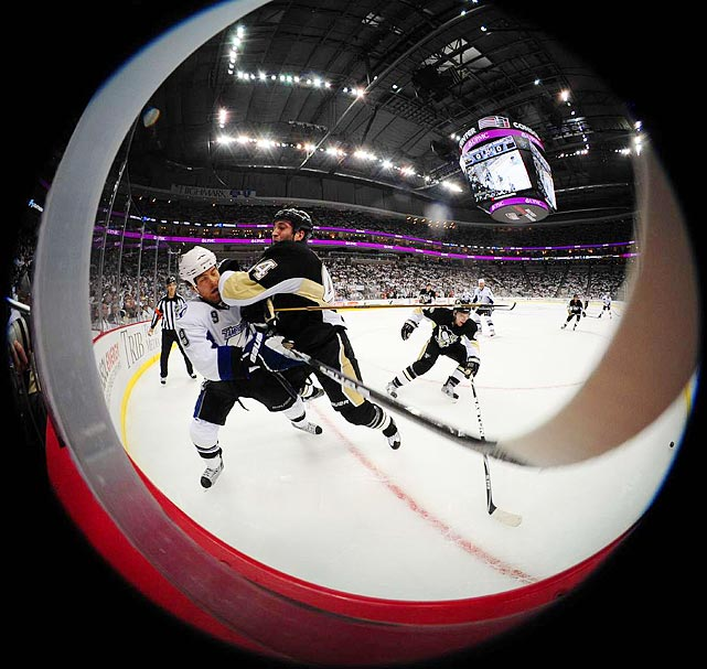 Sports Illustrated  photographer Fred Vuich snaps a fisheye view of Penguins defenseman Brooks Orpik (right) checking Lightning forward Steve Downie during Game 1 of their Stanley Cup quarterfinal match.