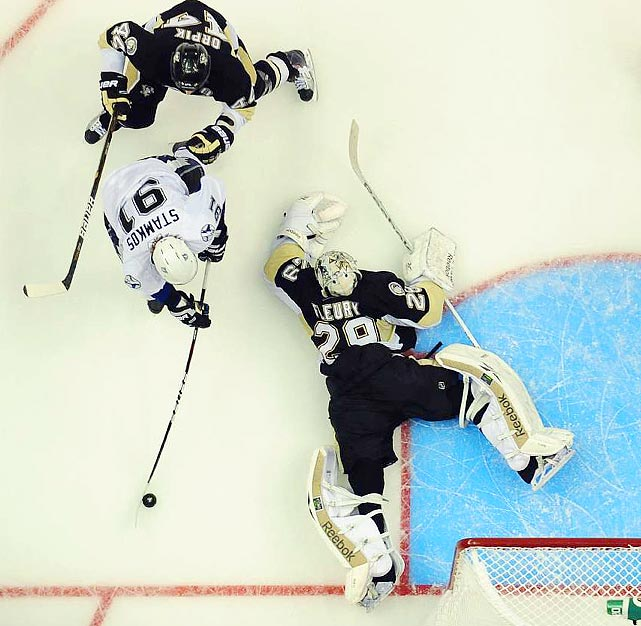 Pittsburgh Penguins goalie Marc-Andre Fleury (29) goes on all fours to defend a shot from Tampa Bay Lightning center Steven Stamkos (91) during the Lightning's 5-1 victory over the Penguins.