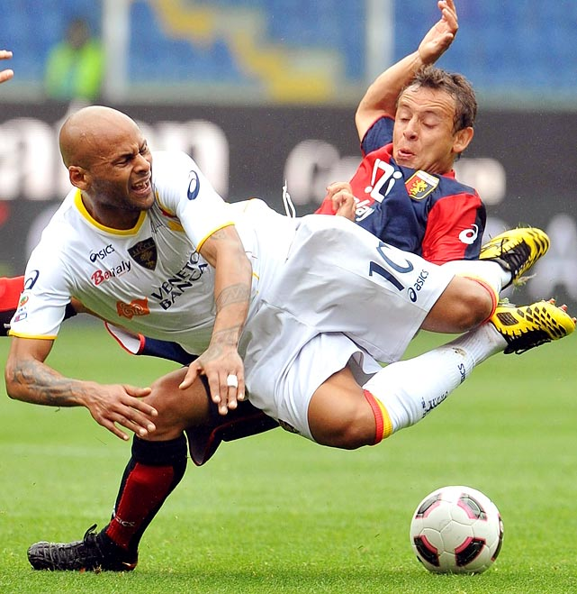 Lecce midfielder Ruben Olivera (left) collides with Genoa midfielder Rafinha during Genoa's 4-2 victory over Lecce on April 23. The loss knocked Lecce into the relegation zone.