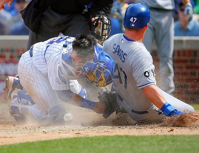 Given the impact of Los Angeles Dodgers outfielder Jerry Sands' (right) slide, it's not surprising Chicago Cubs catcher Geovany Soto (left) bobbled this throw home on April 23. Sands was safe, but the Cubs went on to defeat the Dodgers 10-8.
