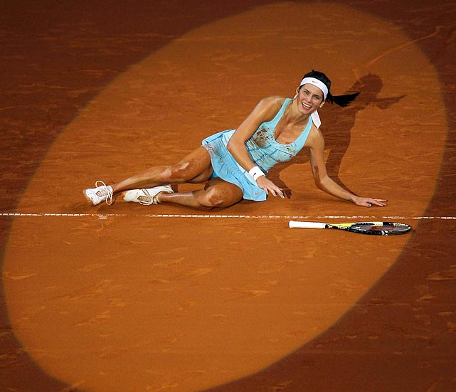 Squarely in the spotlight, Germany's Julia Gorges celebrates winning the Stuttgart Grand Prix by rolling the clay.