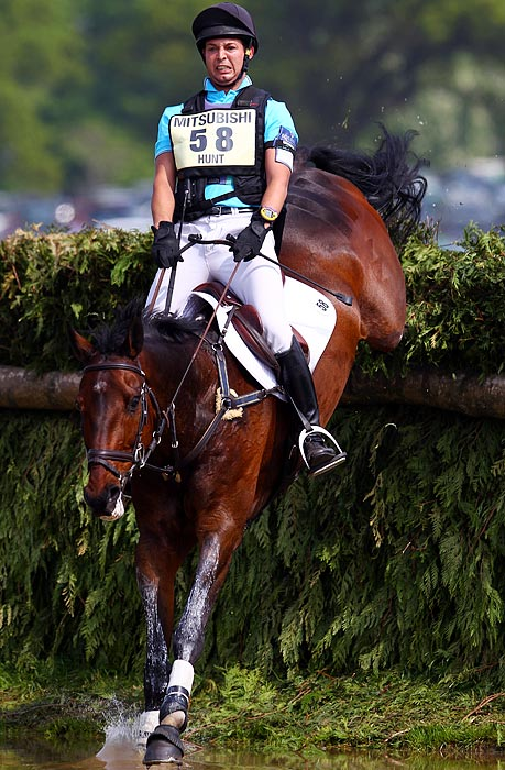 Rider Laurence Hunt braces for impact while riding her horse Phoebus in the cross country stage of the Badminton Horse Trials on April 24.