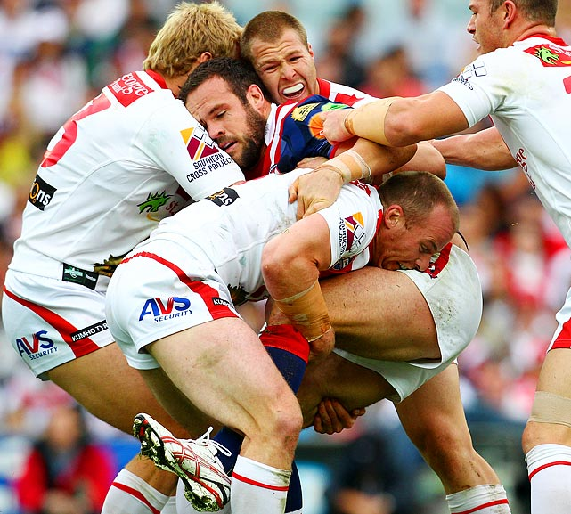 Sydney Roosters player Nate Myles (center) is sandwiched on all sides by members of the St George Illawarra Dragons' defense during a seventh round National Rugby League match on April 25.