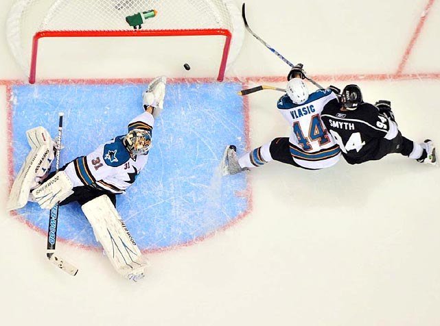 Los Angeles Kings rightwinger Justin Williams (not pictured) was credited with this goal at 16:04 when his cross-ice pass for Ryan Smyth (right) deflected into the net off the stick of San Jose Sharks defenseman Marc-Edouard Vlasic in Game 4 of the Western Conference quarterfinals.