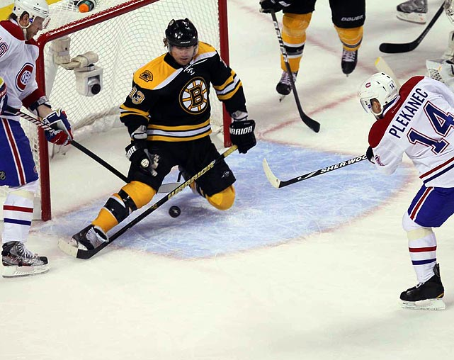 With Boston Bruins goalie Tim Thomas lured out of the net, rightwinger Michael Ryder stepped in and denied a would-be goal from Montreal Canadiens center Tomas Plekanec during Game 5 of the Eastern Conference quarterfinals. The Bruins would go on to beat the Canadiens 2-1 in double overtime.