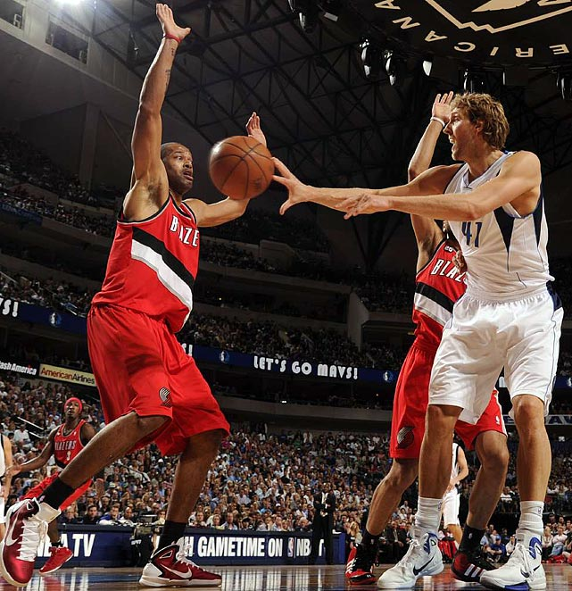 Watch out! Ever fearless, Trail Blazers center Marcus Camby (left) steps in front of a pass from Mavericks forward Dirk Nowitzki during Game 1 of the Western Conference quarterfinals.
