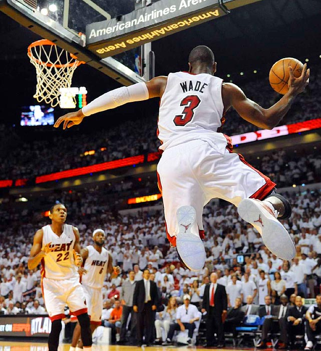 Miami Heat guard Dwyane Wade saves a pass from out of bounds during the Heat's Game 1 victory over the 76ers in the Eastern Conference quarterfinals.